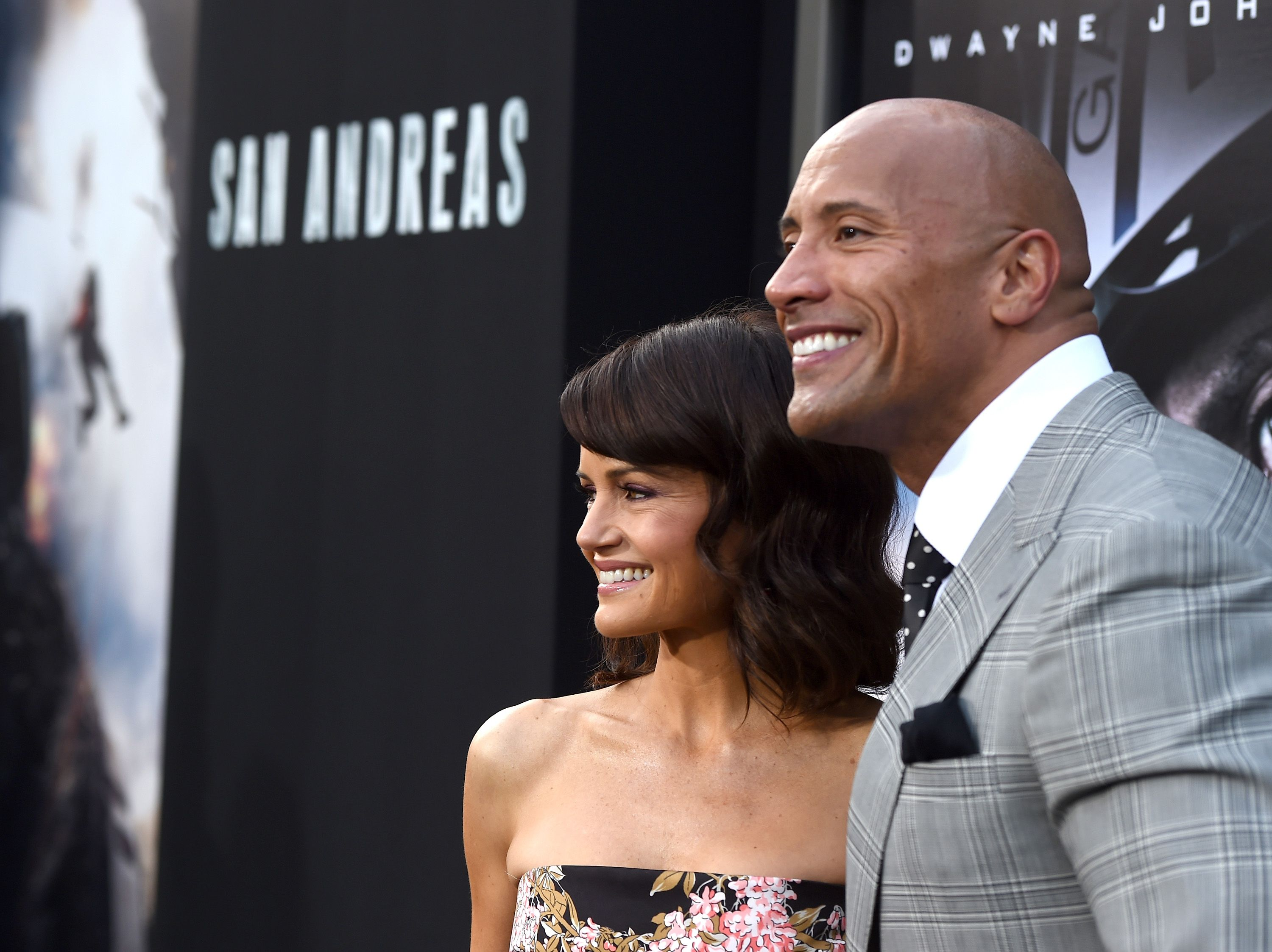 Carla Gugino and The Rock arrive at the Premiere Of Warner Bros. Pictures' 'San Andreas' at TCL Chinese Theatre on May 26, 2015 in Hollywood, California.