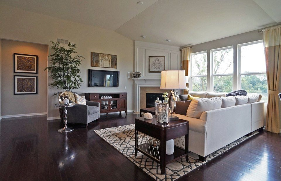 Traditional Living Room with Westington Candlestick Raw Nickel Spindle Accent Table, Hardwood floors, stone fireplace