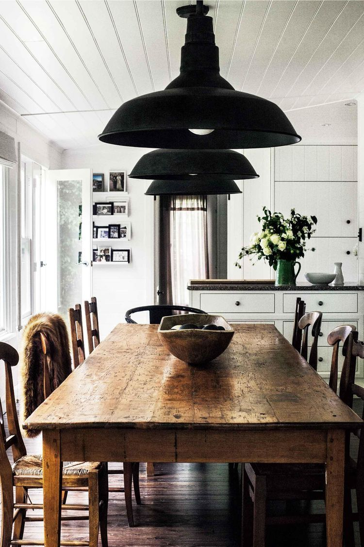 That table and warm rustic brown against the black and white kitchen ...