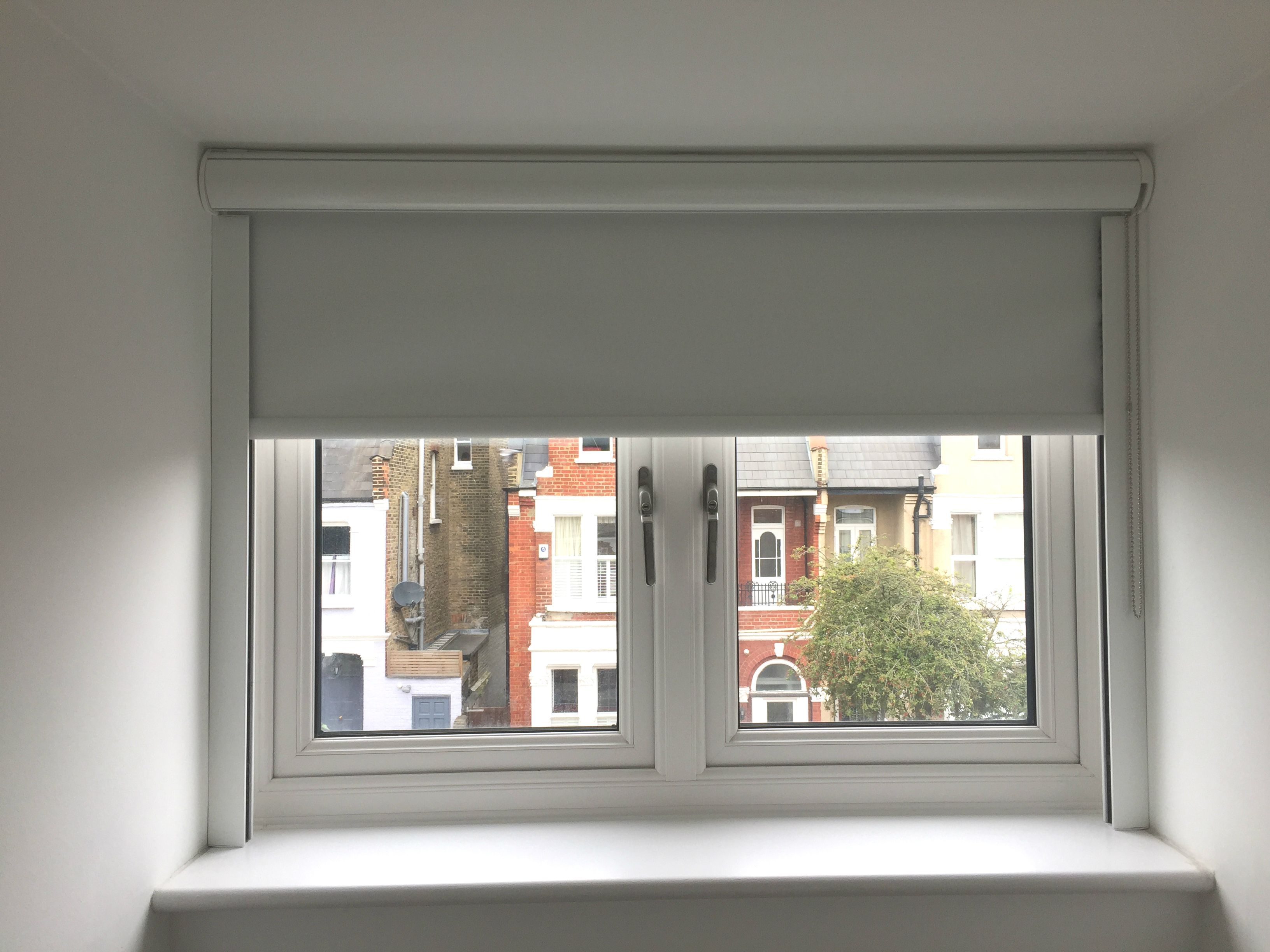 Blackout Roller Blind In Polar White With Cassette And