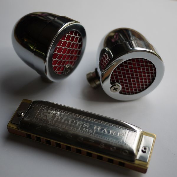 Small Chrome Bullet microphone for harmonica. by Harp Skunk, via Behance This is what I build, take a listen to the sample.