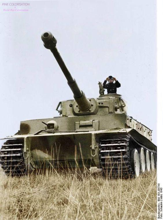 A German tank commander surveying the field atop his Panzerkampfwagen VI Tiger I Ausf. E Tank. #27B (Color)