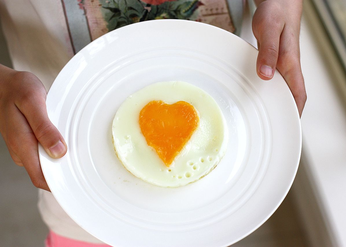 Fried Egg with Love. Separate egg, Well oiled heart cookie ...