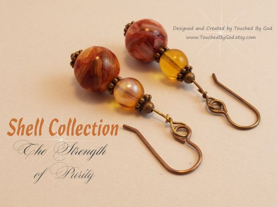 Timeless dangle earrings are handmade with Grade A Fresh Water Round Shell Beads. All metal components including the metal beads, daisy spacers, headpins, eyepins and French earwires are brass. These earrings make a great gift for yourself or for that special woman in your life! Visit my shop at www.TouchedByGod.etsy.com.