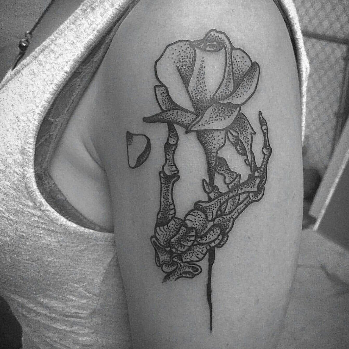 Skeleton hand holding a rose tattoo. First tattoo