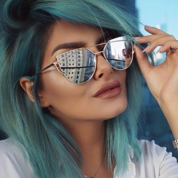 18a4890268 Balenciaga Accessories - Silver mirrored cat eye sunglasses ...