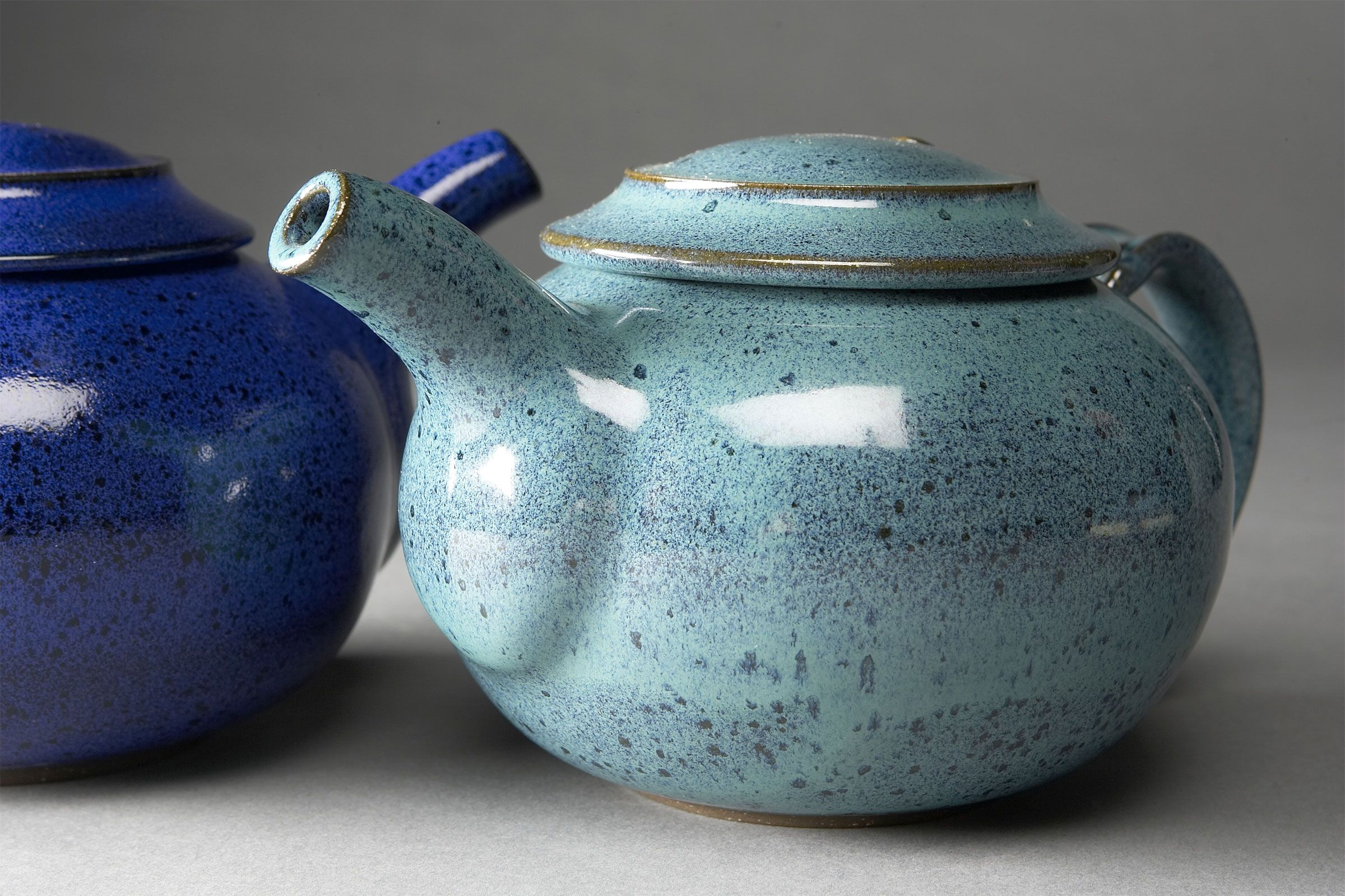 Small teapots in Blue Frost and Persian Willow Creek Pottery