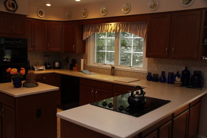 Kitchen cabinets refaced to look better than new | Kitchen Magic ...