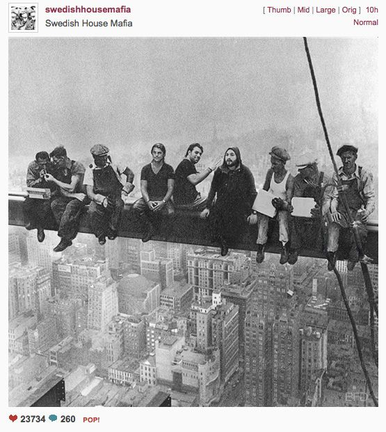 eleven ironworkers eat their lunch sitting on iron beam CLASSIC POSTER 24X36