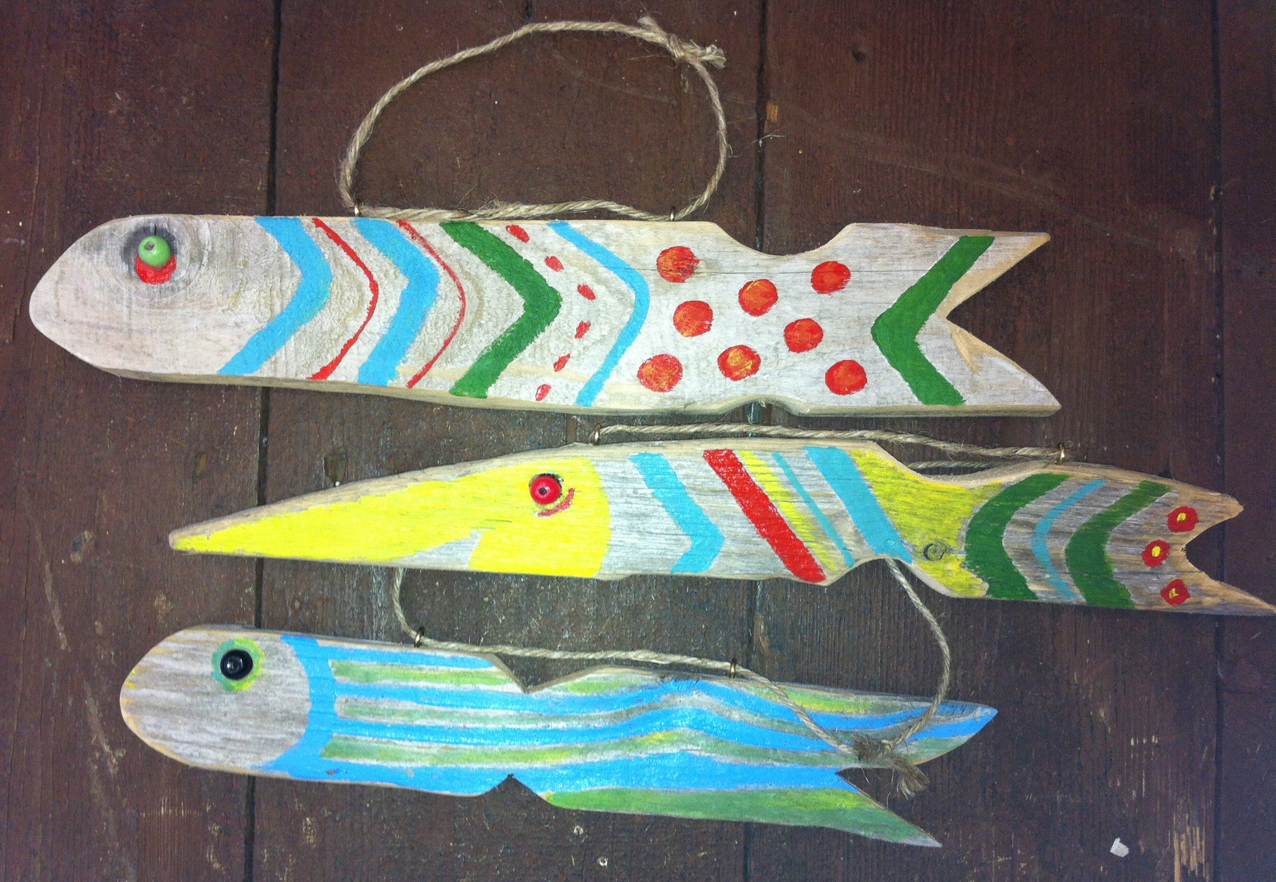 driftwood with acrylic paint  patterns ... decorate a shed or fence?