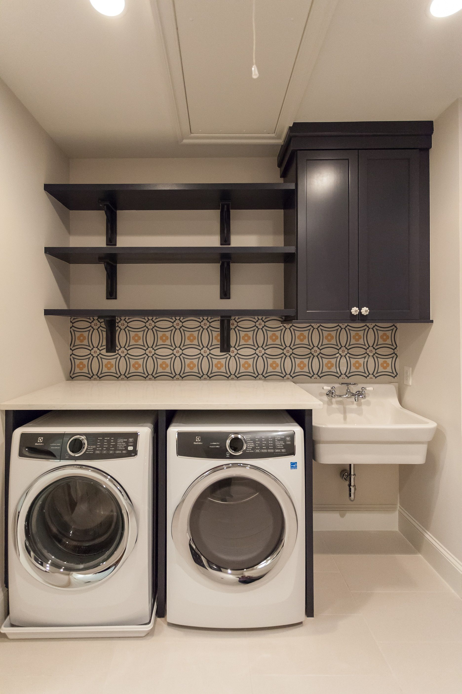 Laundry Room With Purple Cabinets And Open Shelves With