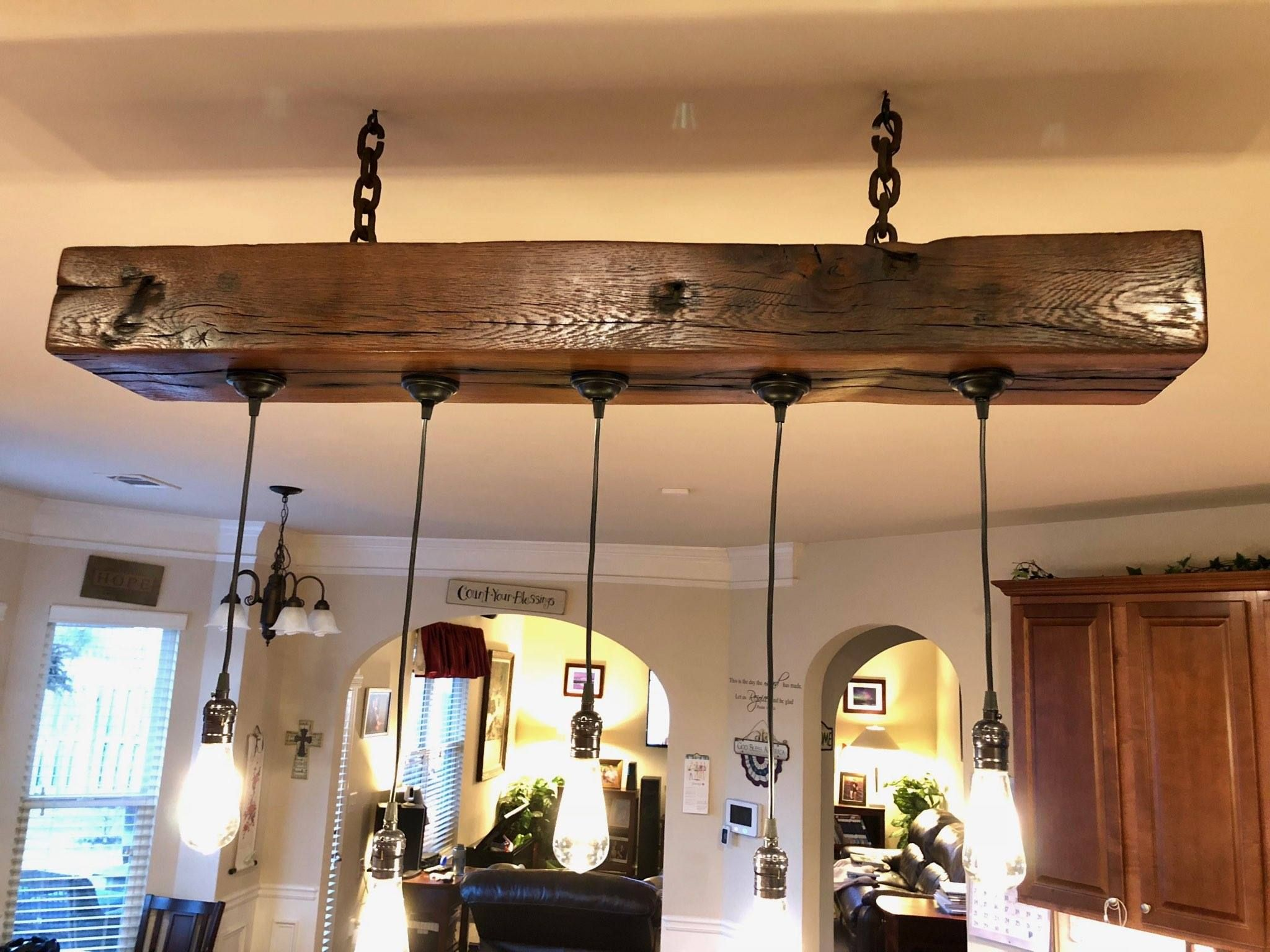 Scott hamilton of greenville sc made this beautiful light fixture using one of our reclaimed beams i love the mix of rustic wood and the contemporary