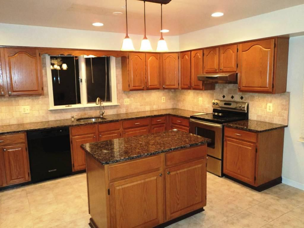 White Kitchen Black Appliances subway tile backsplash with oak cabinets - google search | kitchen