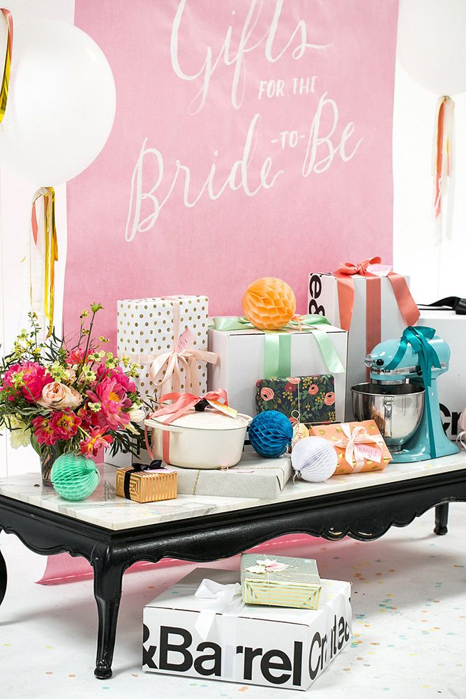 hosting a bridal shower get 100layercakes tips for making the gift table extra special for the bride to be