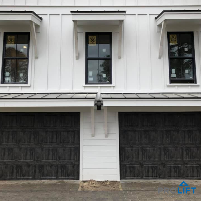Garage Door Styles And How To Choose The Right One For Your Home In 2020 Garage Door Styles Garage Doors Faux Wood Garage Door