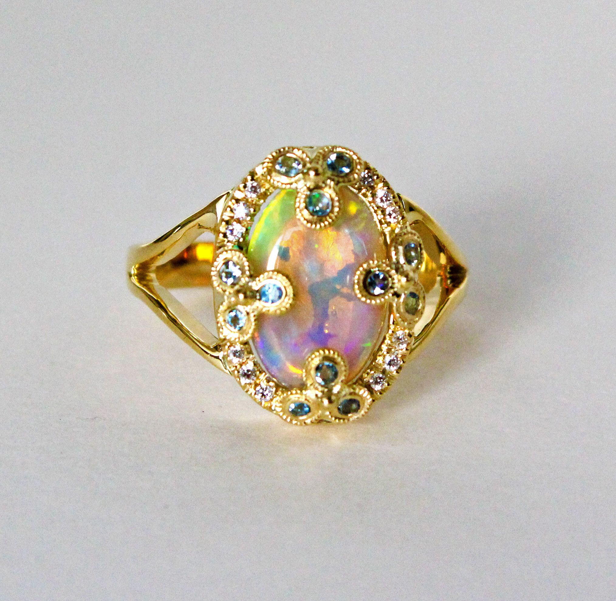 A customer's finished custom order of large opal, aquamarine, white diamond and 14k yellow gold ring. www.sarahhughes.net