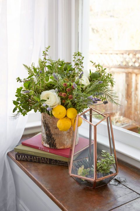 "This delightfully overgrown bouquet amps up its rustic design when placed in a birch vase (like this one). Its ""just-picked"" style is especially striking next to a tidy terrarium of succulents. Click through for more flower arranging tips and tricks."