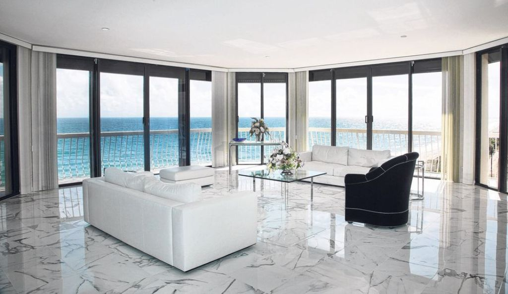 Living room with a white polished marble floor and with a beautiful sea  view  marbleLiving room with a white polished marble floor and with a  . Living Room Flooring Designs. Home Design Ideas
