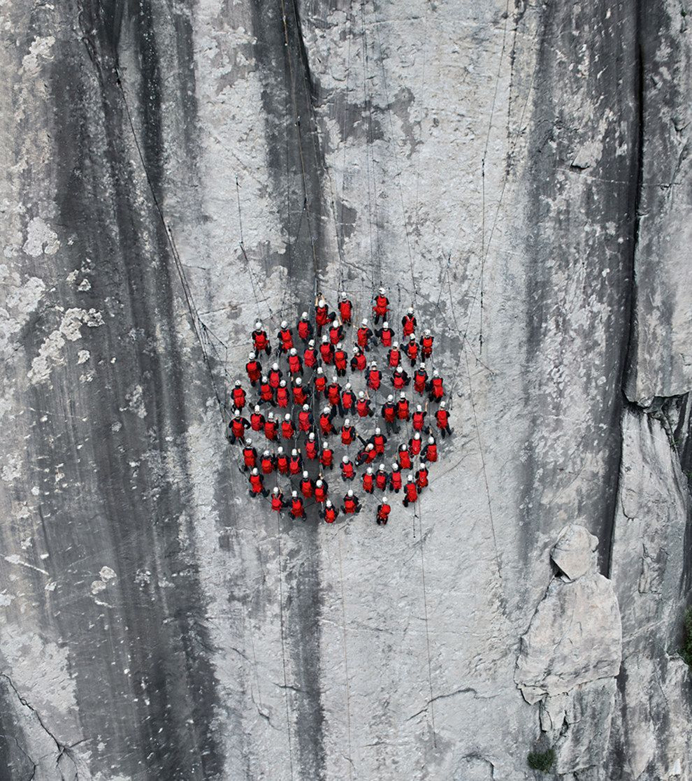 amous moutaineering photographer Robert Bösch snapped hundreds of risk-taking mountain climbers in a photo shoot in the Alps to celebrate 150 years since the first ascent of the Hörnligrat Ridge of The Matterhorn, Switzerland.