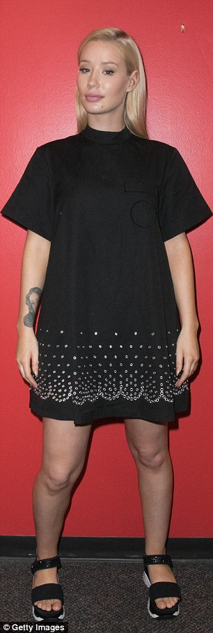 Pushing the envelope:For her chat with Elvis, the Fancy star wore a loose fit T-shirt dress with metal eyelet embellishment and a high neck