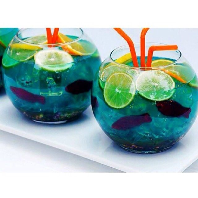 The Fish Bowl  6 oz Vodka  6 oz. Coconut Rum  4 oz. Peach Schnapps  4 oz. UV Vodka 2L Sprite  Nerds Candy Swedish Fish Candy  Orange Slices
