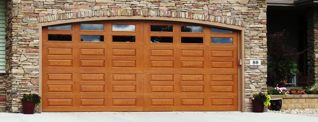 This garage door looks like real wood but with less maintenance