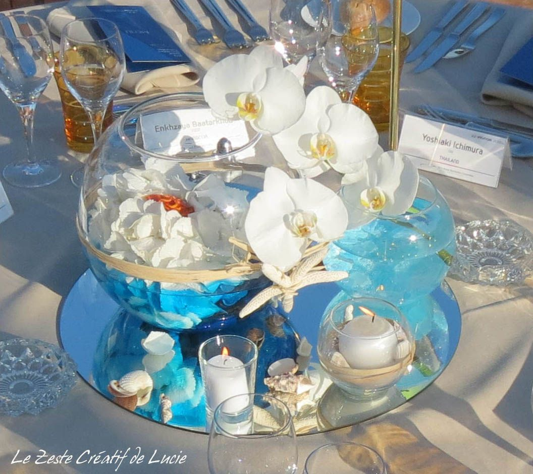 Cr ation des centres de table sur le th me de la mer tryptique de vases boules chaque vase Centre table mariage plage idees