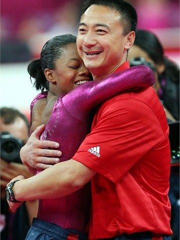 Gabrielle Douglas of the United States hugs her coach Liang Chow after the floor exercise in the Artistic Gymnastics women's Individual All-Around final on Day 6 of the London 2012 Olympic Games