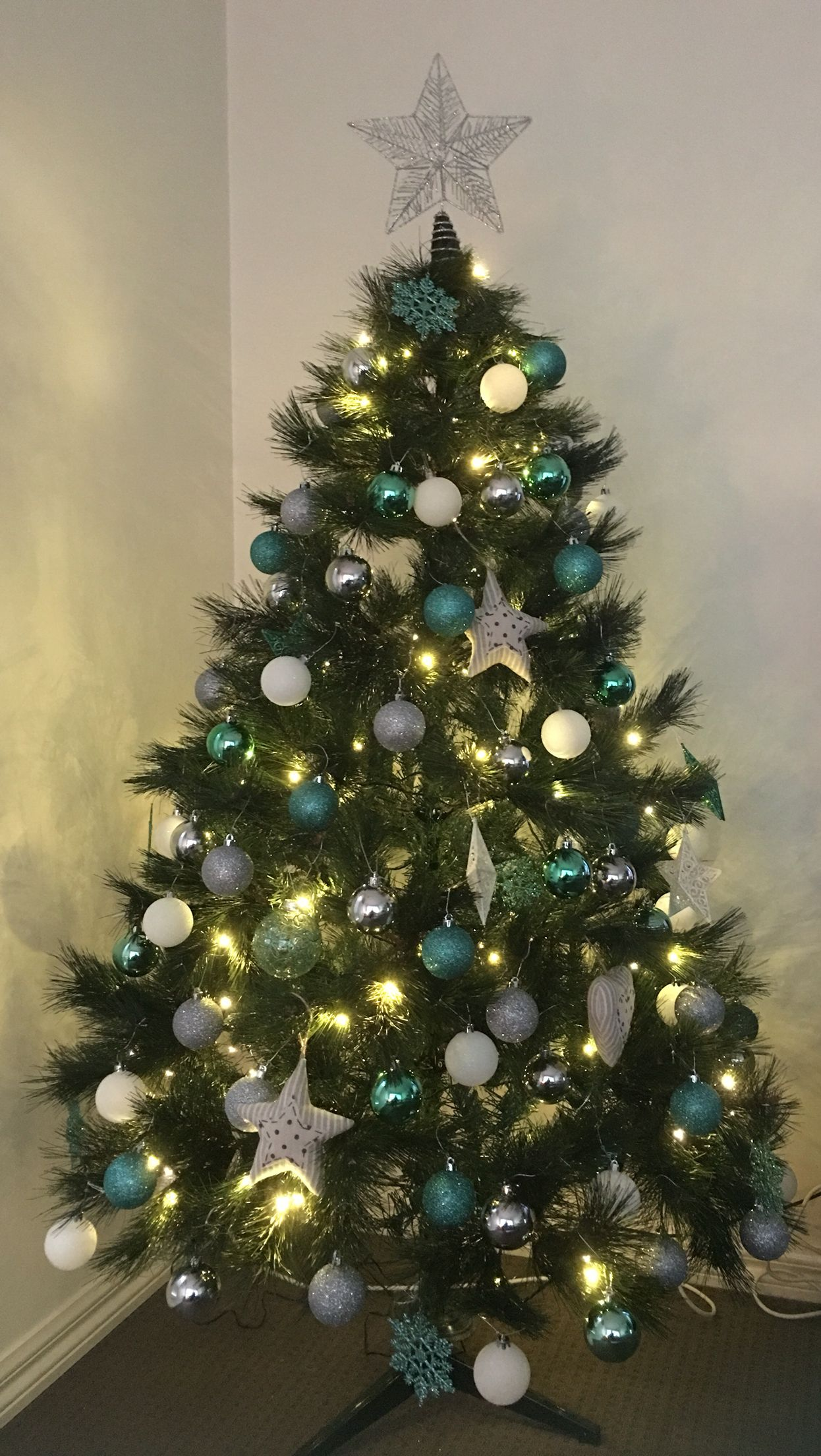 Aqua themed Christmas tree. Tree and decorations from