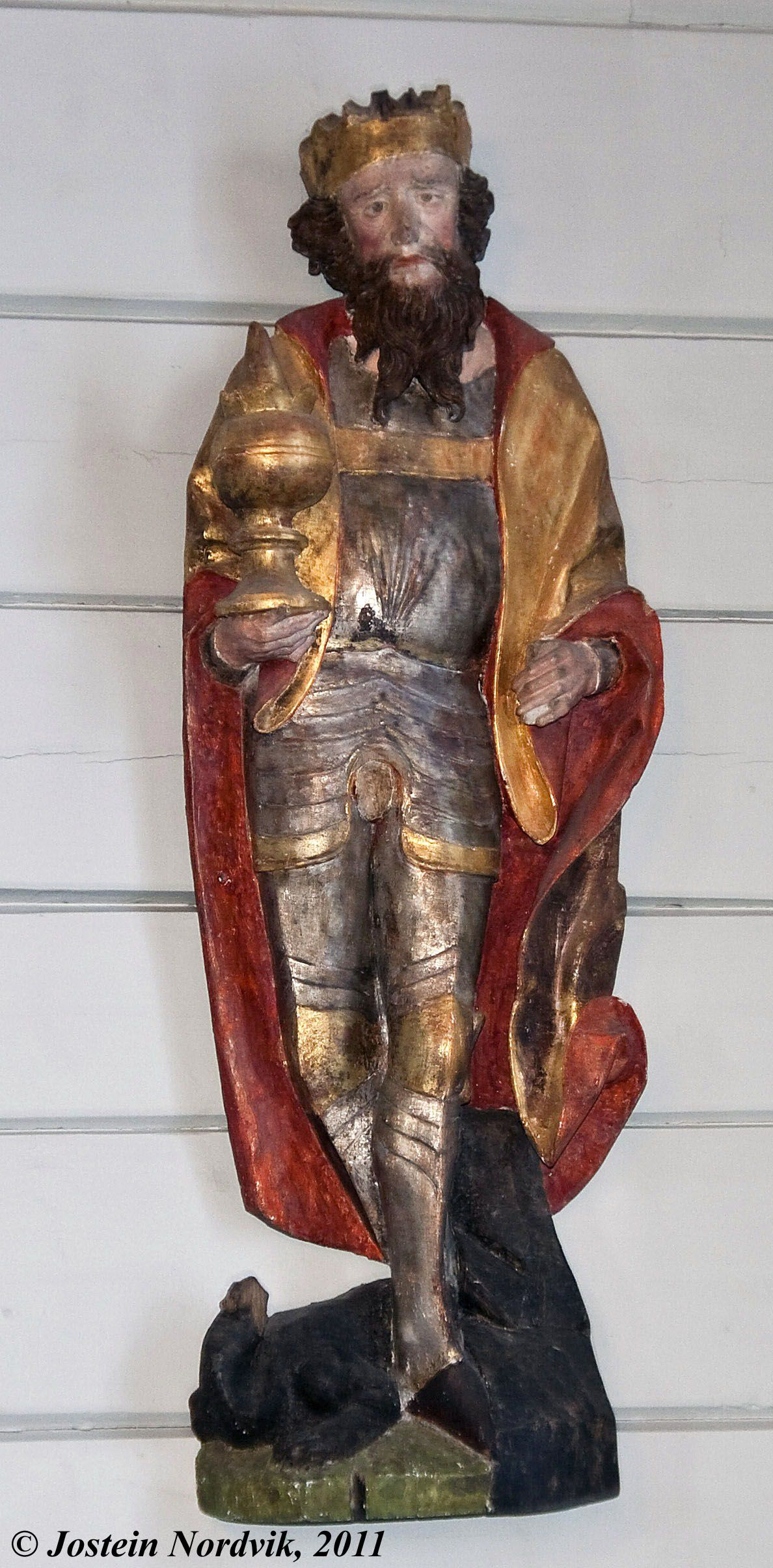 St. Olaf, wooden carved and painted statue from before 1500.