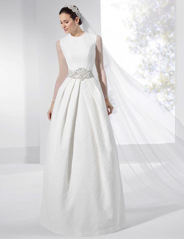 vestidos de novia con falda amplia y mangas de seda natural. | boda