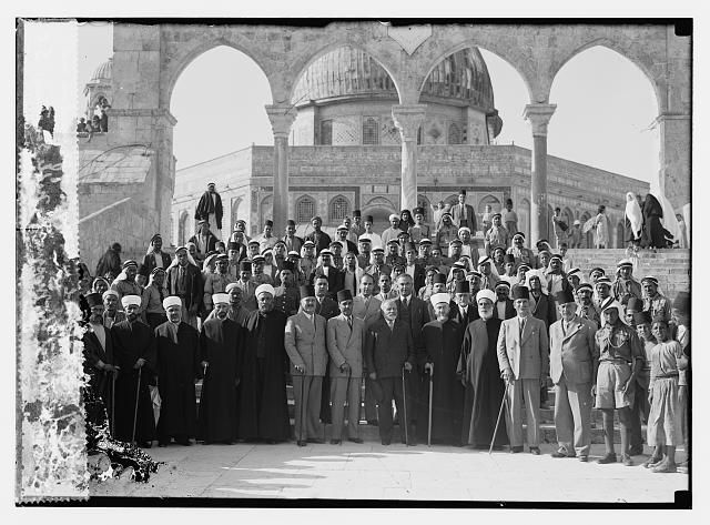 """Group of boys school with Mufti of Jerusalem  and notable visitors at the mosque. """"The Noble"""" Sanctuary, Jerusalem"""