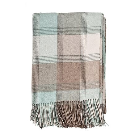 Woven in Scotland, this merino wool throw offers chic style for your favorite wingback or summer picnics.    Product: Throw