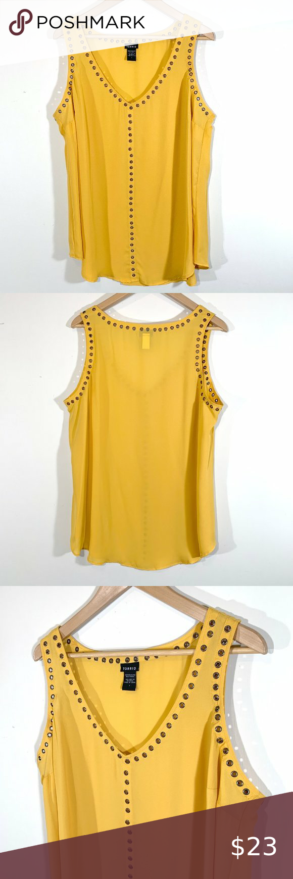 Torrid | Grommet V-Neck Tank Top V-neck tank top by Torrid. Collar, sleeve openings, and front of top lined with metal grommets. Round hem. Lightweight, somewhat sheer, mustard yellow fabric. In great condition. Torrid size 1 (equivalent to 1X).  Materials: 100% Polyester  Size Guide (From Torrid Website) Size: 1 (1X / 14-16) Bust: 42