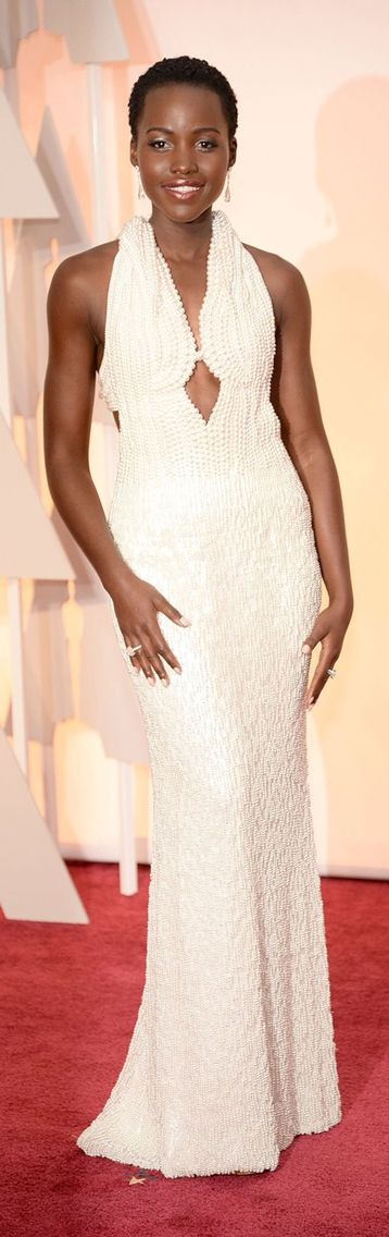 Lupita Nyong'o wearing the natural- pearl encrusted Calvin Klein gown by Francisco Costa and styled by Micaela Erlanga #Oscars 2014
