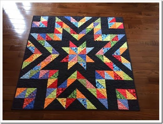 Awesome quilt!  Great stash buster