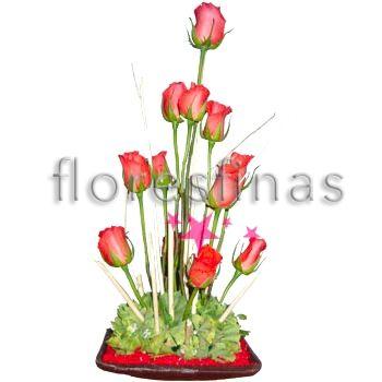 centro de mesa con rosas naranja