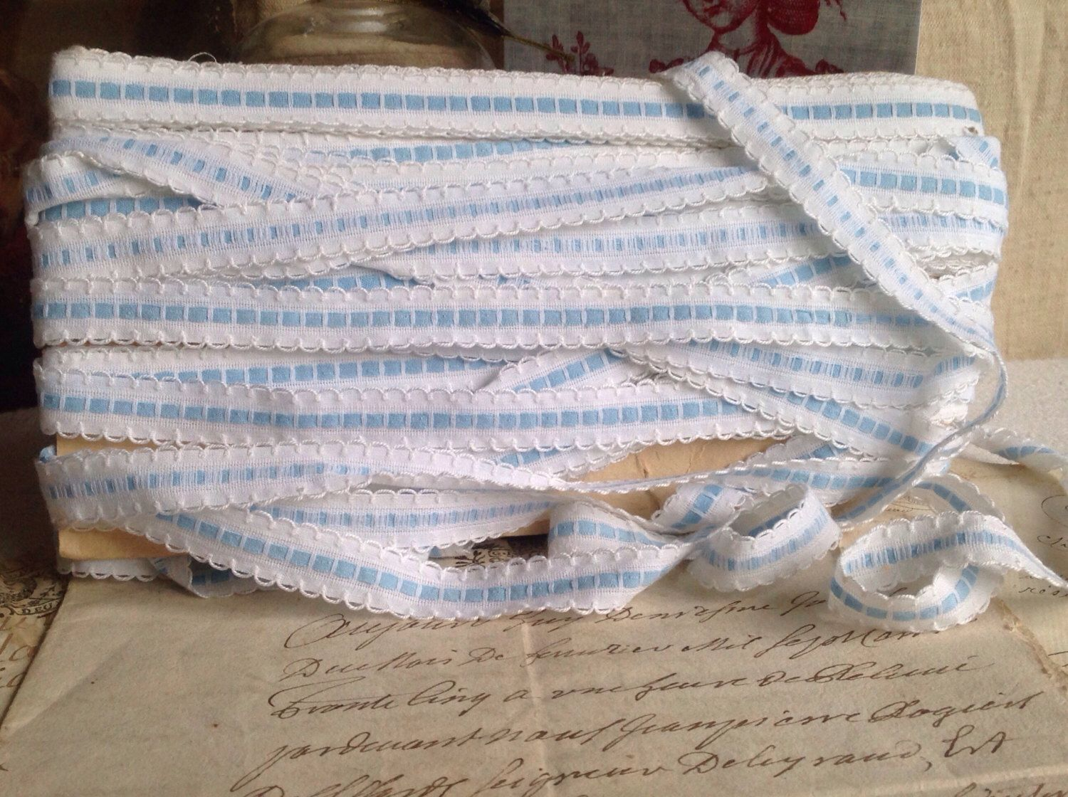 A personal favourite from my Etsy shop https://www.etsy.com/uk/listing/475207168/vintage-trim-french-blue-tape-ribbon-5