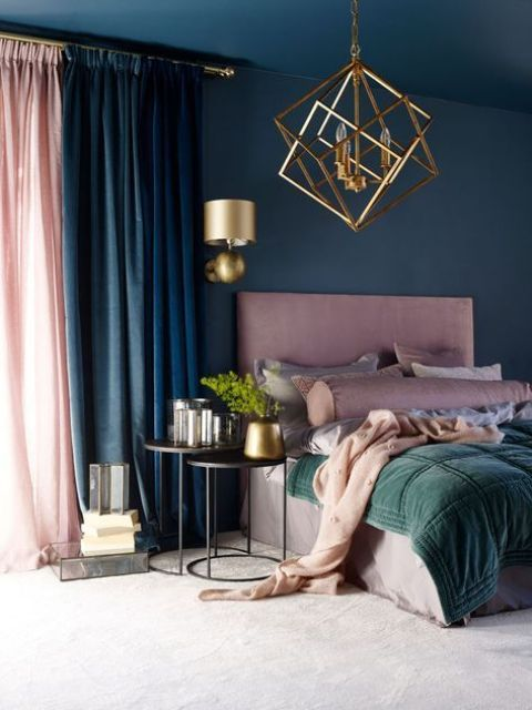 a gorgeous bedroom done in navy, dark green and dusty pink ...