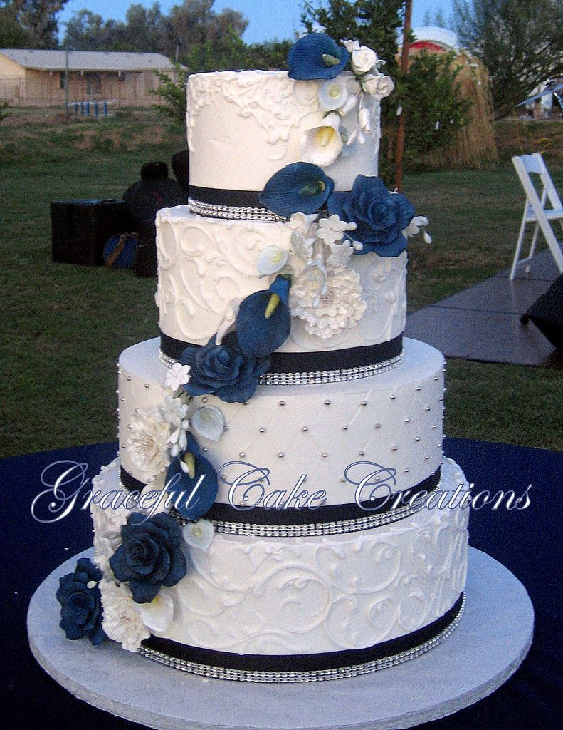 Elegant White Butter Cream Wedding Cake With Navy Blue Ribbon And