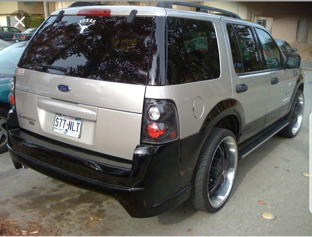 2002 silver Ford Explorer customized with body kits Ford