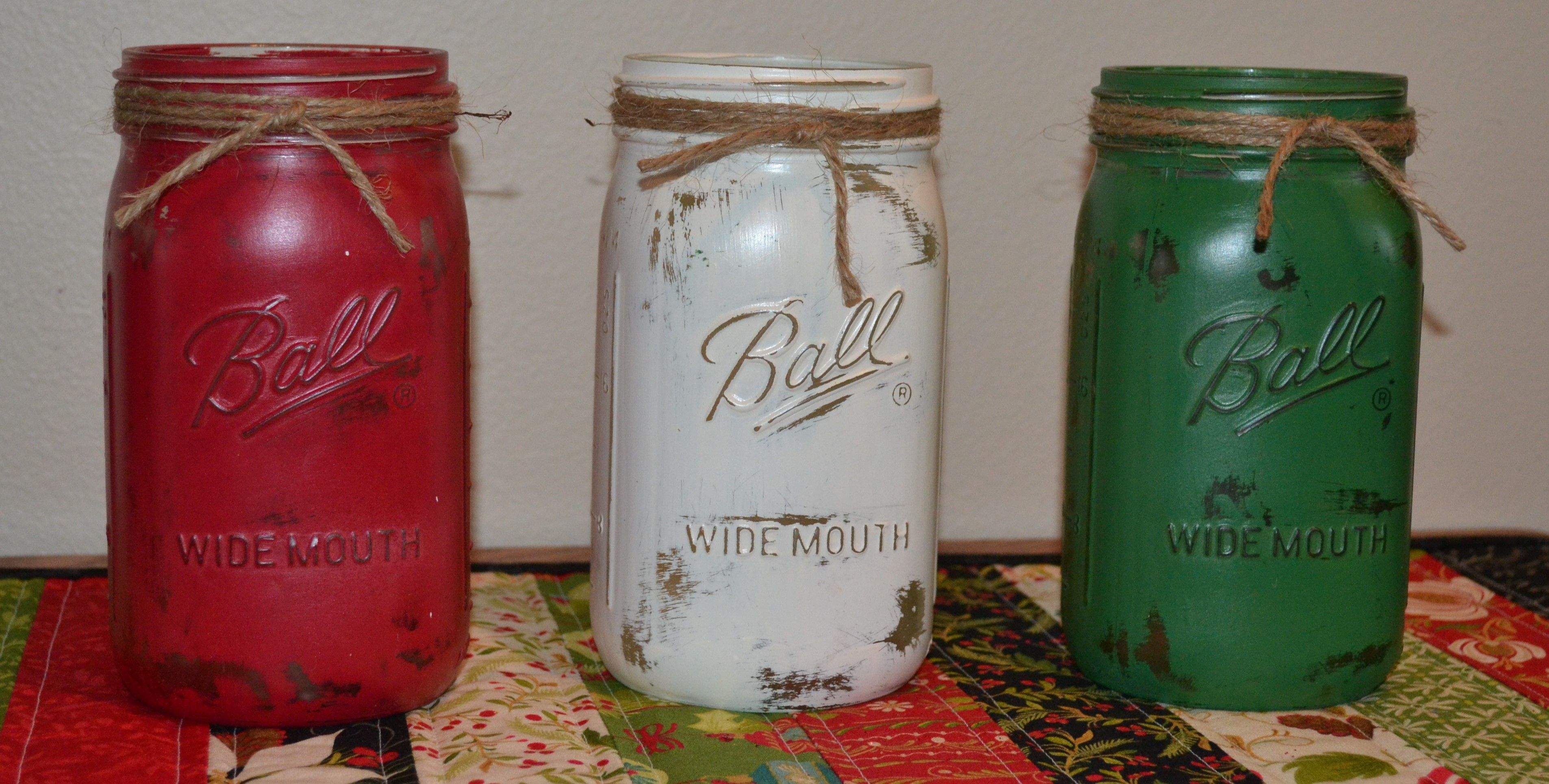 distressed mason jars wrapped with jute twine christmas colors