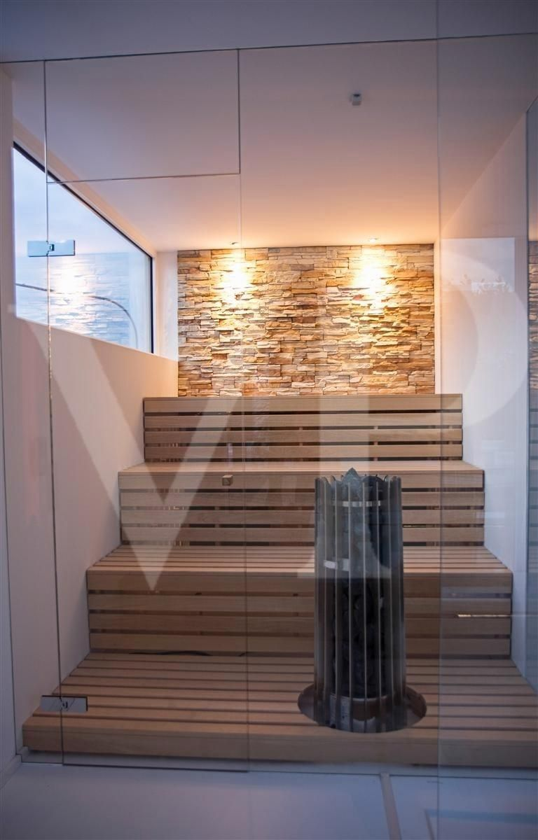 Sauna with Interior Brick Wall Detail and Panorama Window