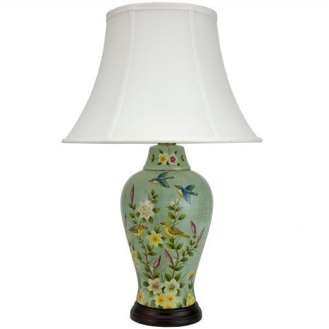 A warm summer scene adorns the sides of this decorative porcelain lamp. Inspired by mid-century paintings, this lamp depicts blue songbirds in flight over