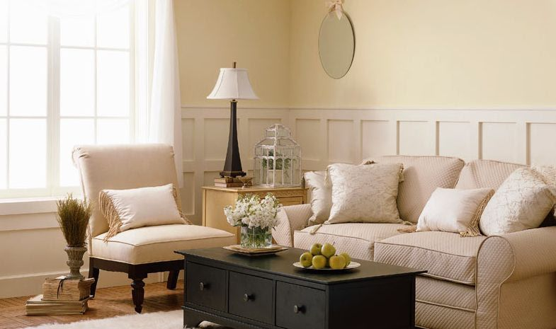 room with white furniture off white creme neutral living room color
