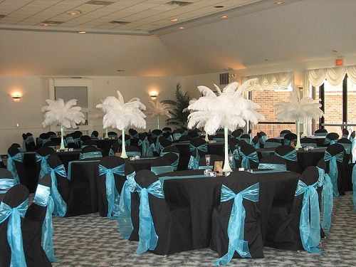 WHITE FEATHER TABLE DECORATION This banquet hall has a contrast look as the dark tables have been decorated with white ostrich feather decorative pieces. & WHITE FEATHER TABLE DECORATION This banquet hall has a contrast look ...