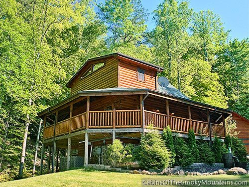 What a great wraparound porch. This is Shady Creek Retreat, a 1-bedroom luxury hideaway near Pigeon Forge with its own private stream.