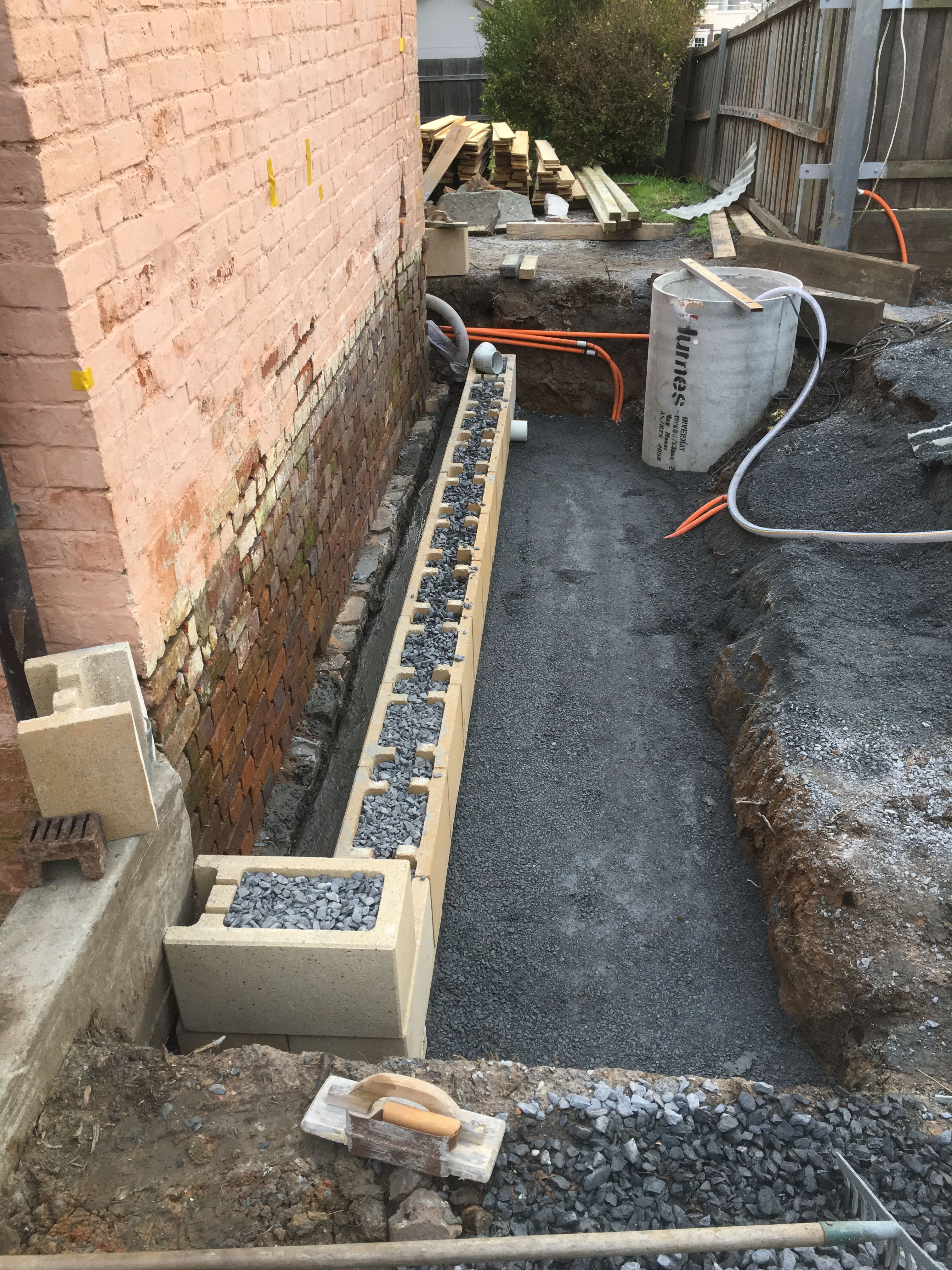 Property Drainage Works Retaining Wall Under Construction To Allow An Air Gap Between The Foundations And Earth Fill