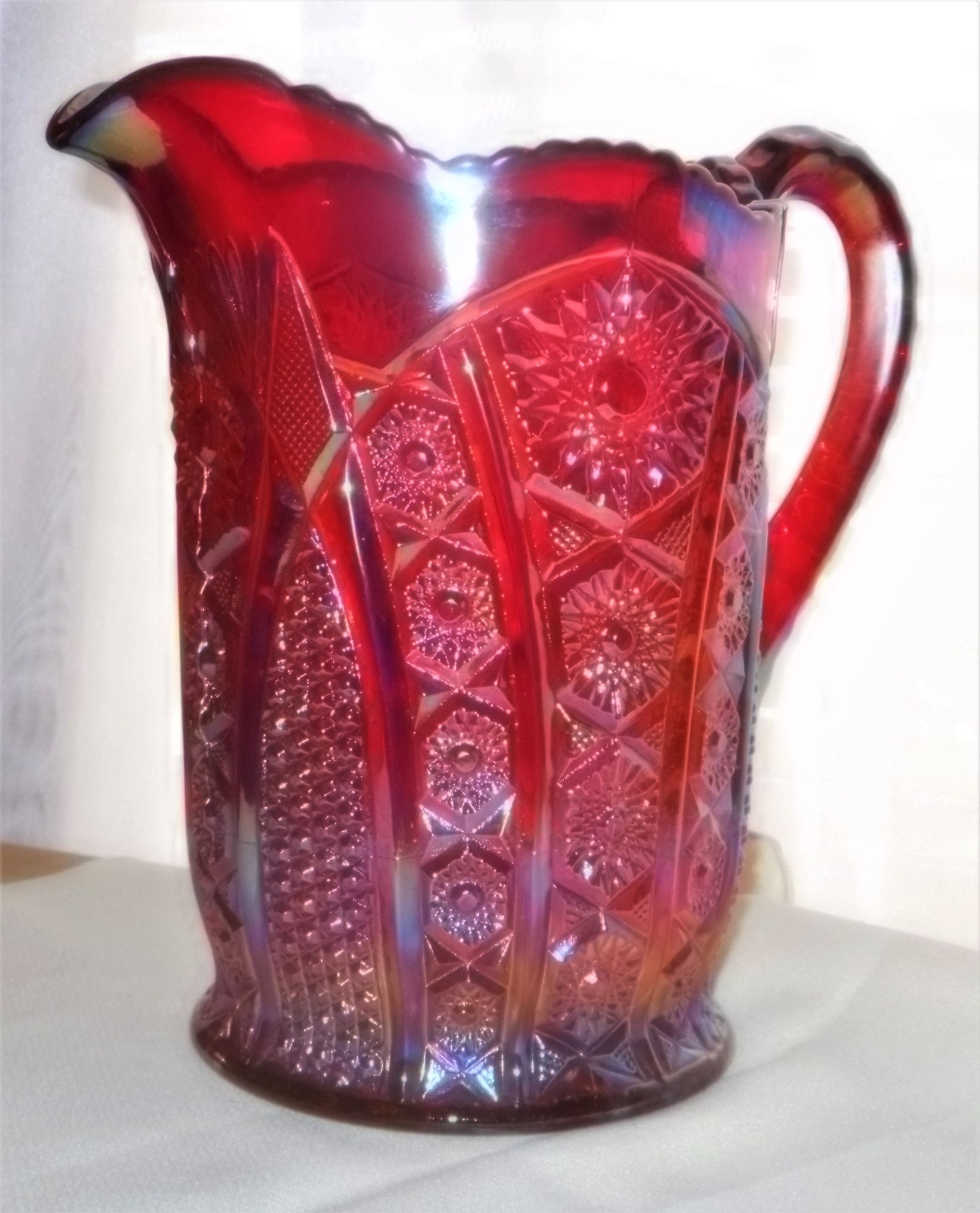 iridescent red carnival glass pitcher in heirloom pattern sunset