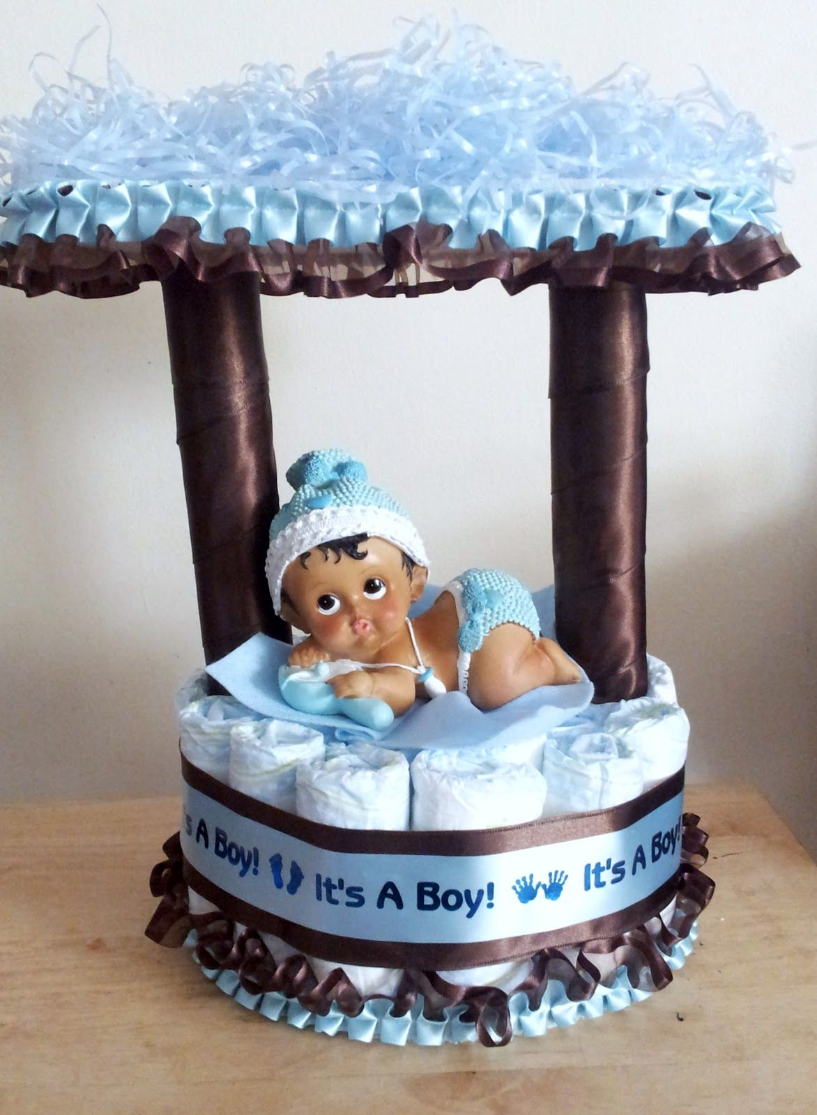 Blue Camo Baby Shower Decorations | Light blue and brown baby boy wishing  well pamper cake.